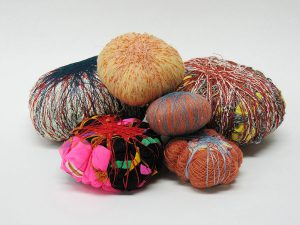 Sheila Hicks, Six Soft Stones, silk, wool, linen, monofilament, mohair, nylon, cotton, garments - wrapped, 1997