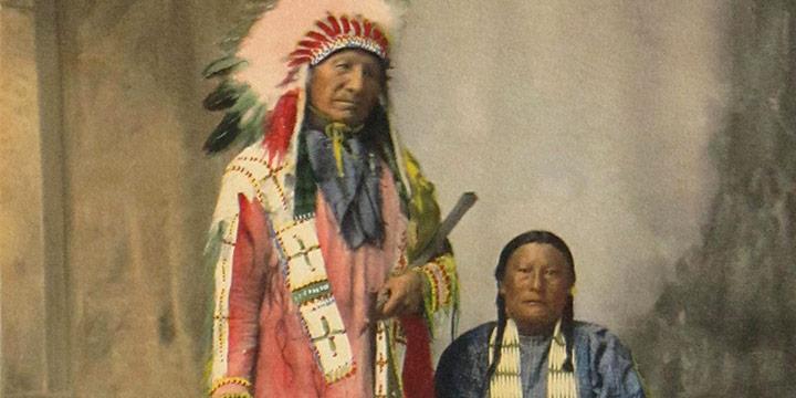 Adolph F. Muhr (Rinehart Studio), Chief American Horse & Squaw, Sioux, handcolored platinum print, 1898