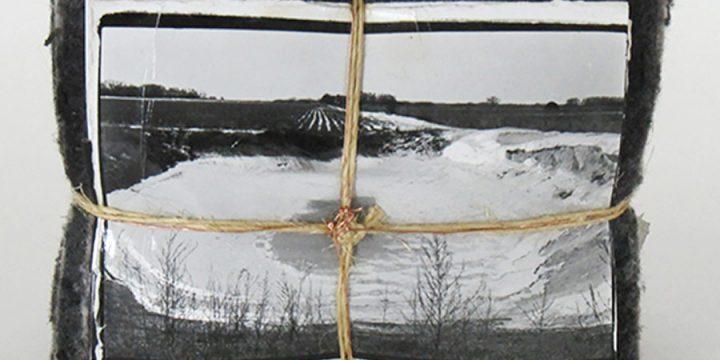 Craig Roper, Winter Landscape (Hettrich property, frozen silage pit, west of Palmer, Nebraska -1980, photo bundle: carpet felt, destressed photographs, tar paper, cardboard, twine, wire, 1990-2006