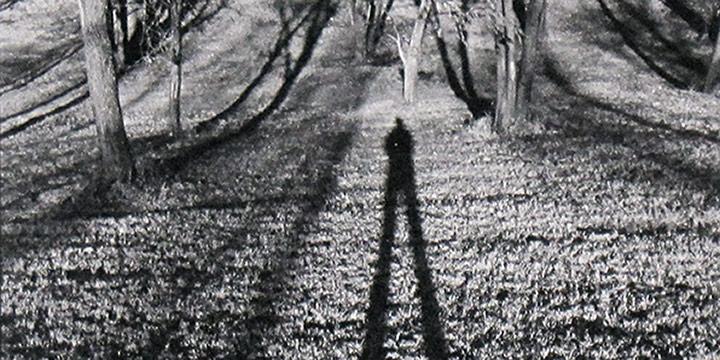 Don Doll, Self Portrait: Walking Tall, black & white photograph, 1976