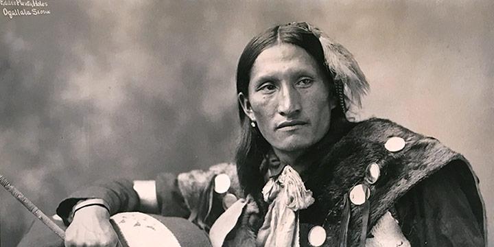 Herman Heyn, Eddie Plenty Holes, Ogallala Sioux, black & white photograph, 1899