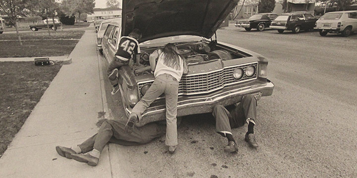 George Tuck, Working on the Car, Denver, CO, black & white photograph, 1977