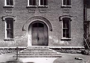 Wright Morris, School House Facade with Sleeping Dog, Nebraska, 1947