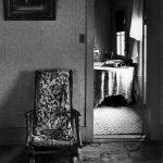 "Wright Morris, Platform Rocker, View through Door, Ed's Place, Near Norfolk, Nebraska, 1947, silver print, 1975, 10 × 8"""