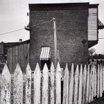 Wright Morris, Picket Fence and Building, Near Chester, Pennsylvania, 1940, silver print, 1975
