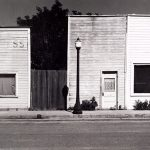 Wright Morris, Stores with False Fronts, Western Kansas, 1943, silver print, 1975