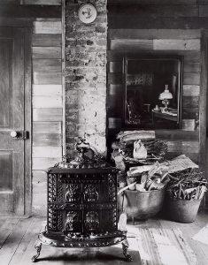 Wright Morris, Interior with Cast Iron Stove, Farmhouse, Near New Albany, Indiana, 1950, silver print, 1975