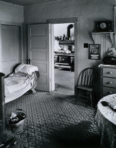 Wright Morris, Living Room, View into Kitchen, Ed's Place, Near Norfolk, Nebraska, 1947 silver print, 1975