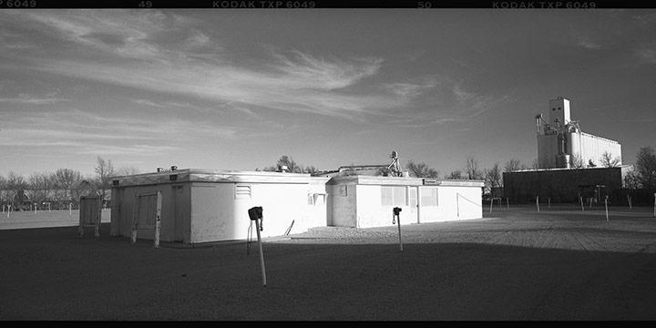 """Michael Flecky, Kearney Drive-In (Projection Booth), Kearney, Nebraska, 2000, silver gelatin photograph, 2000, 5 × 7"""""""