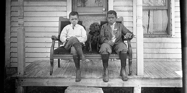 John Johnson, Untitled (two boys and dog on stoop), black & white photograph (from glass plate negative in the MONA Archives Collection), 2018, 11 × 15""