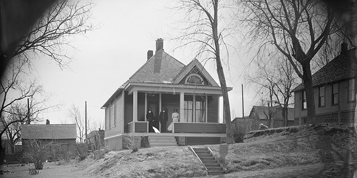 John Johnson, Untitled ( house with two women, one man on porch), black & white photograph (from glass plate negative in the MONA Archives Collection), 2018, 11 × 18½""