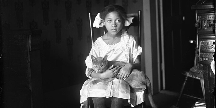 """John Johnson, Untitled (seated girl with cat), black & white photograph (from glass plate negative in the MONA Archives Collection), 2018, 15¼ × 11"""""""